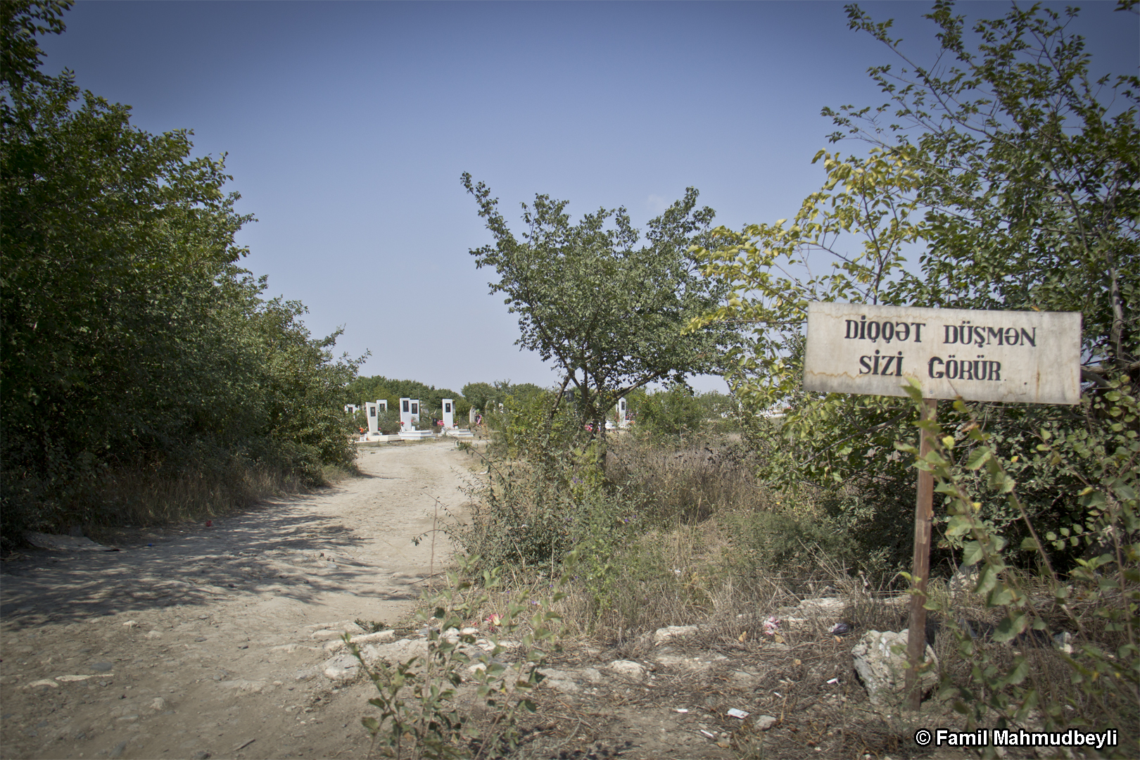 District of Aghdam, 2013. Cemetery of the village of Mirashalli. This cemetery is at a distance of about 200 meters from the Armenian military post. Because of uninterrupted firefights, people have been warned of the danger to their lives in written form.