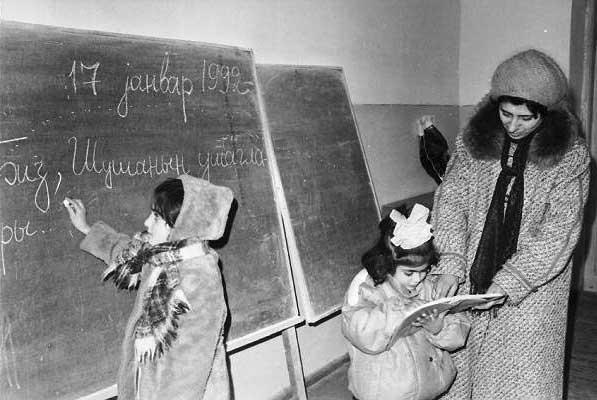 Childen from Shusha studying. 1992. Photo by Khalid Asgarov